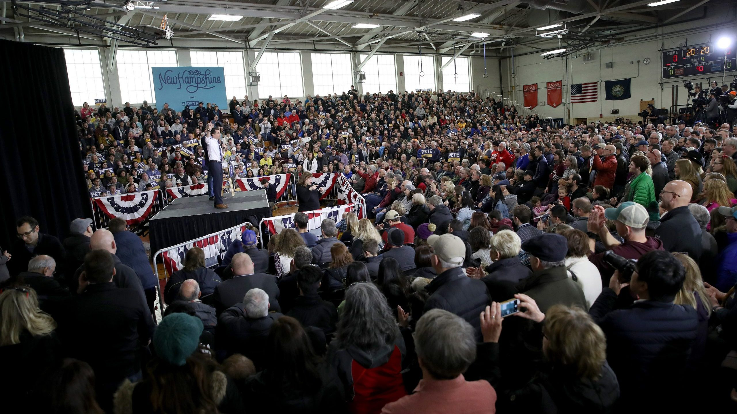 Members of the audience listen as Democratic presidential candidate former South Bend, Indiana Mayor Pete Buttigieg speaks at a Get Out the Vote rally on Feb. 9, 2020, in Nashua, New Hampshire. (Credit: Win McNamee/Getty Images)
