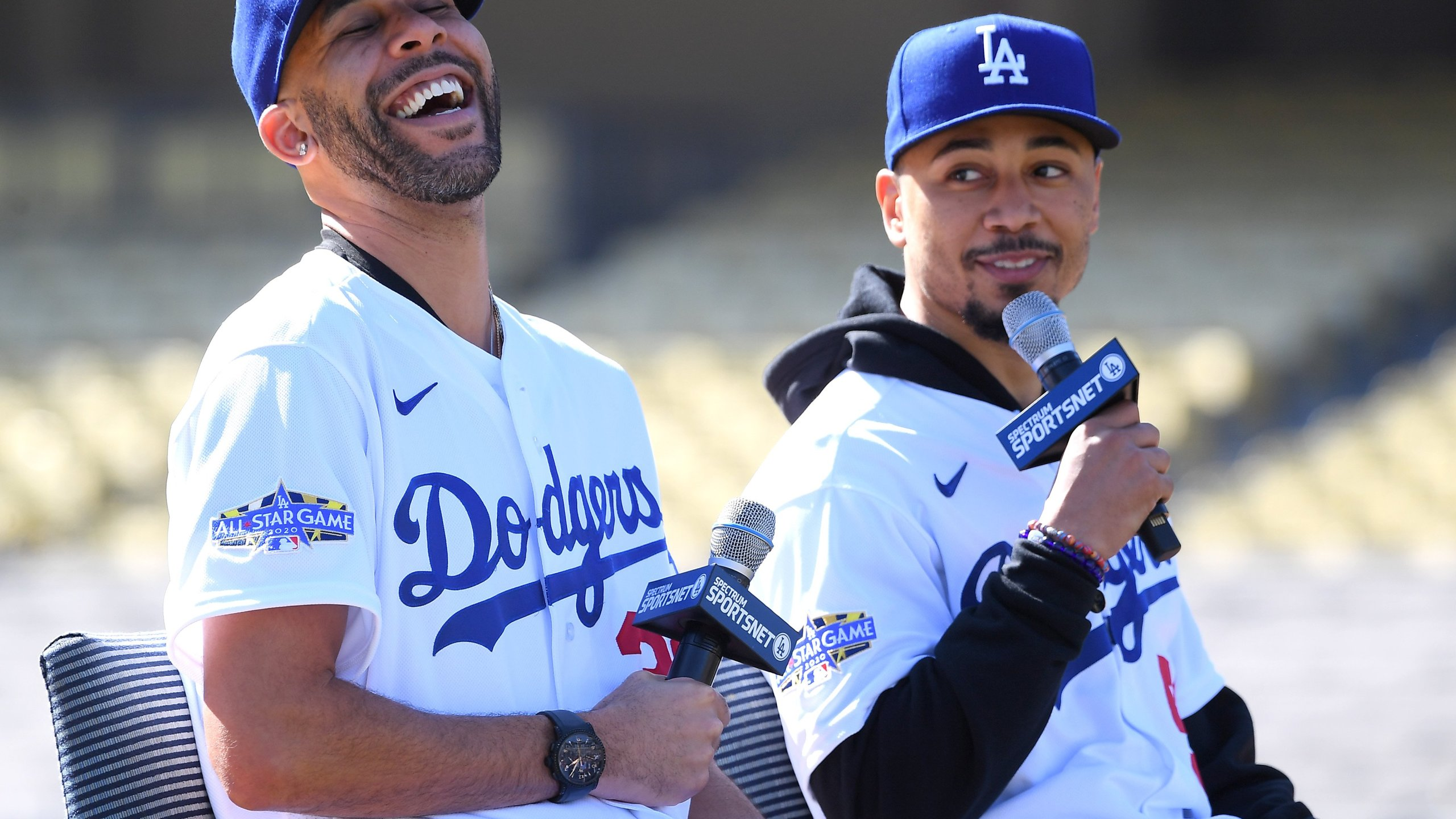 David Price #33 and Mookie Betts #50 of the Los Angeles Dodgers answer questions from the media during an introductory press conference at Dodger Stadium on Feb. 12, 2020. (Credit: Jayne Kamin-Oncea/Getty Images)