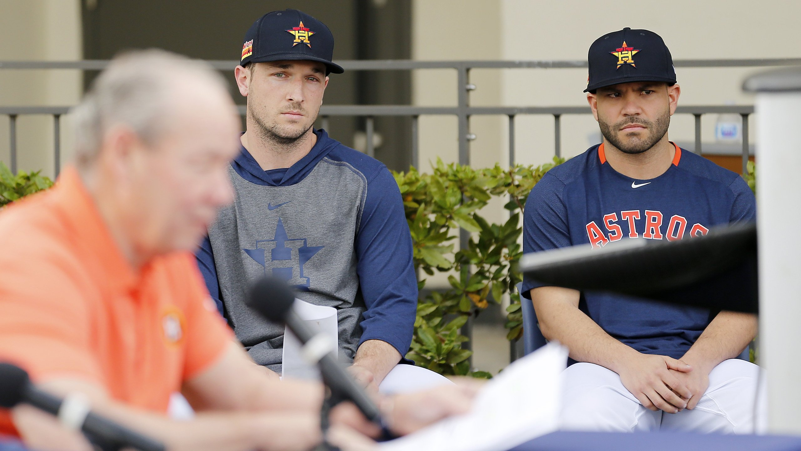 Alex Bregman (left) and Jose Altuve of the Houston Astros look on as owner Jim Crane reads a prepared statement during a press conference on February 13, 2020 in West Palm Beach, Florida. (Credit: Michael Reaves/Getty Images)