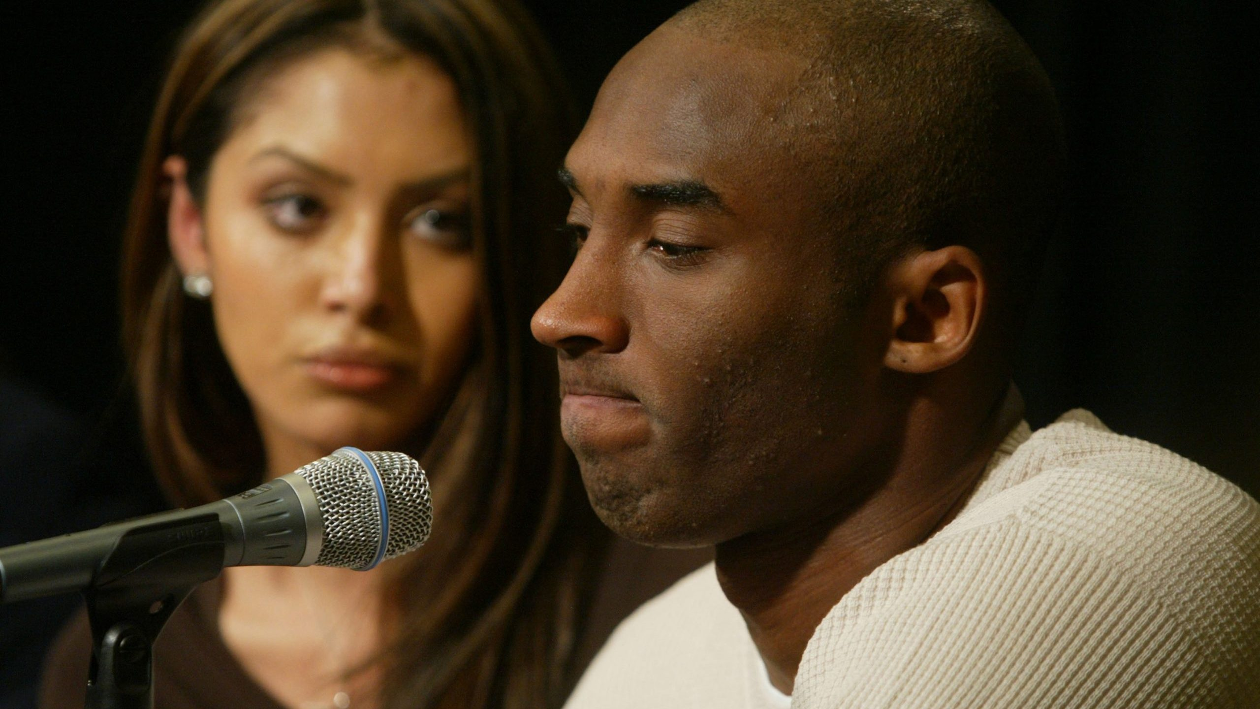 Kobe Bryant and his wife Vanessa attend a news conference at Staples Center on July 18, 2003 in Los Angeles. (Credit: J. Emilio Flores/Getty Images)
