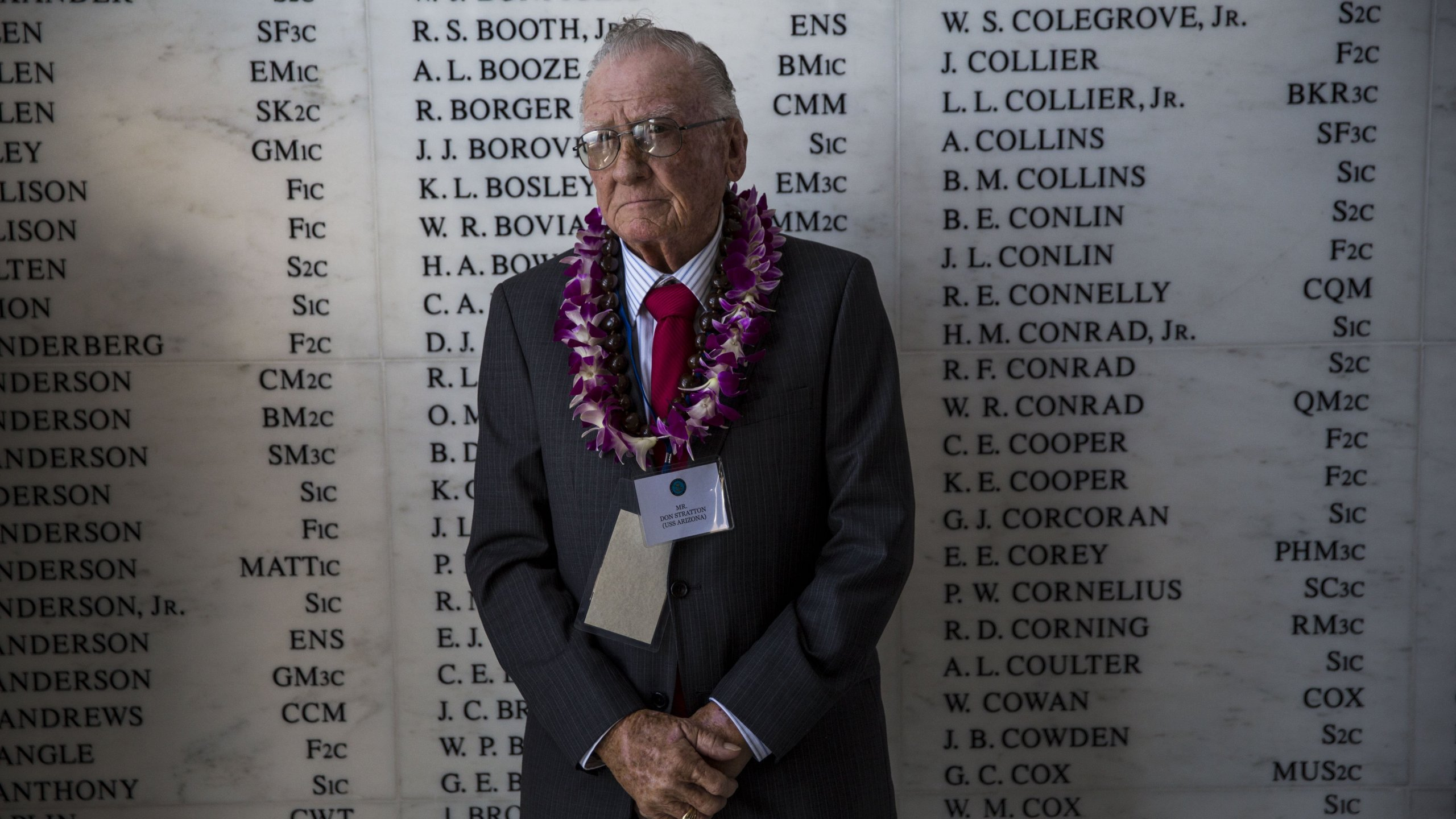 U.S.S. Arizona survivor Donald Stratton stands in front of the remembrance wall in the shrine room the U.S.S. Arizona Memorial during a memorial service for the 73rd anniversary of the attack on the U.S. naval base at Pearl harbor on the island of Oahu at the Pacific National Monument on December 07, 2014 in Pearl Harbor, Hawaii. (Credit: Kent Nishimura/Getty Images)