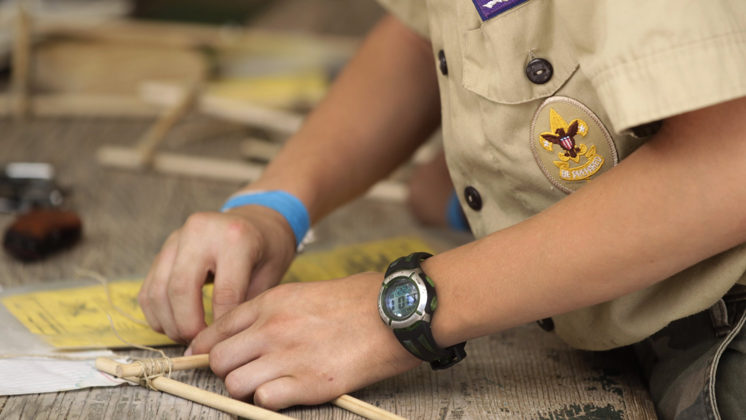 Boy Scouts work on a wood project at camp Maple Dell outside Payson, Utah, on July 31, 2015. (Credit: George Frey / Getty Images)