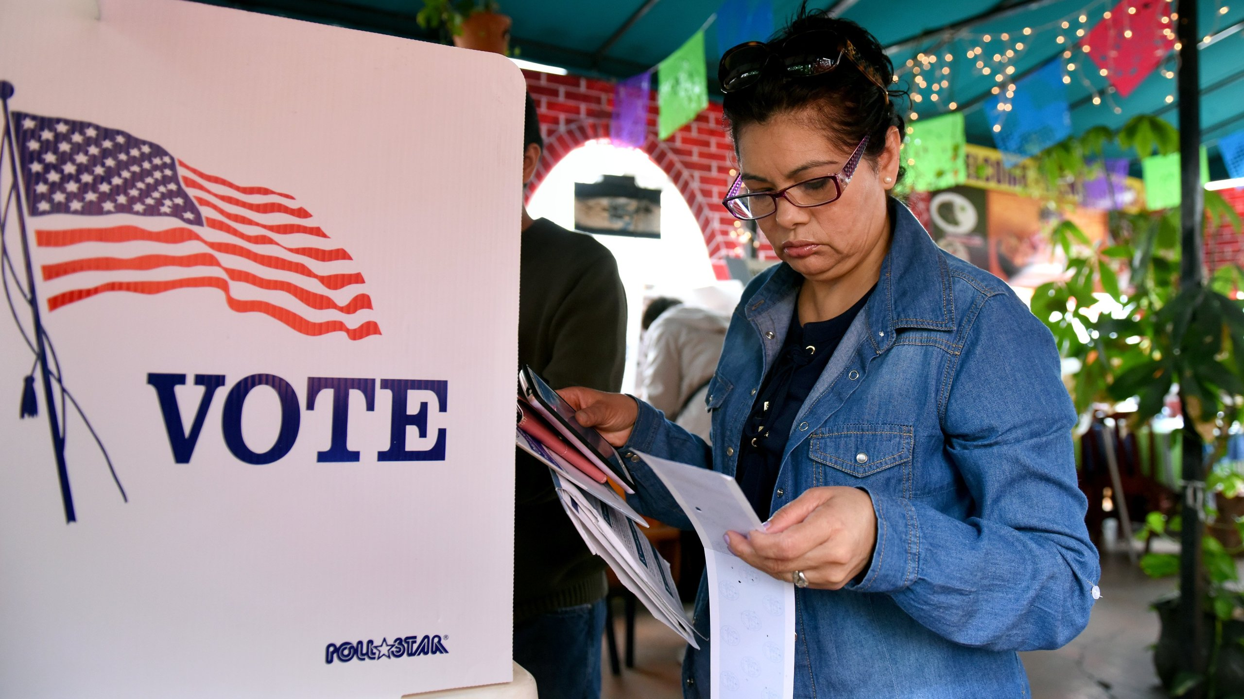 Rosa Ayala checks her ballot after voting in the June 7, 2016, presidential primary at Sabores de Oaxaca, a Mexican restaurant in Mid-City Los Angeles. (Credit: Michael Owen Baker / AFP / Getty Images)