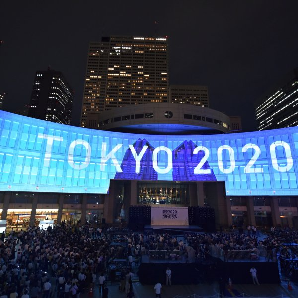 "A projection that reads ""Tokyo 2020"" is seen during a ceremony marking three years to go before the start of the Tokyo 2020 Olympic games at the Tokyo Metropolitan Assembly Building on July 24, 2017. (Credit: KAZUHIRO NOGI/AFP via Getty Images)"