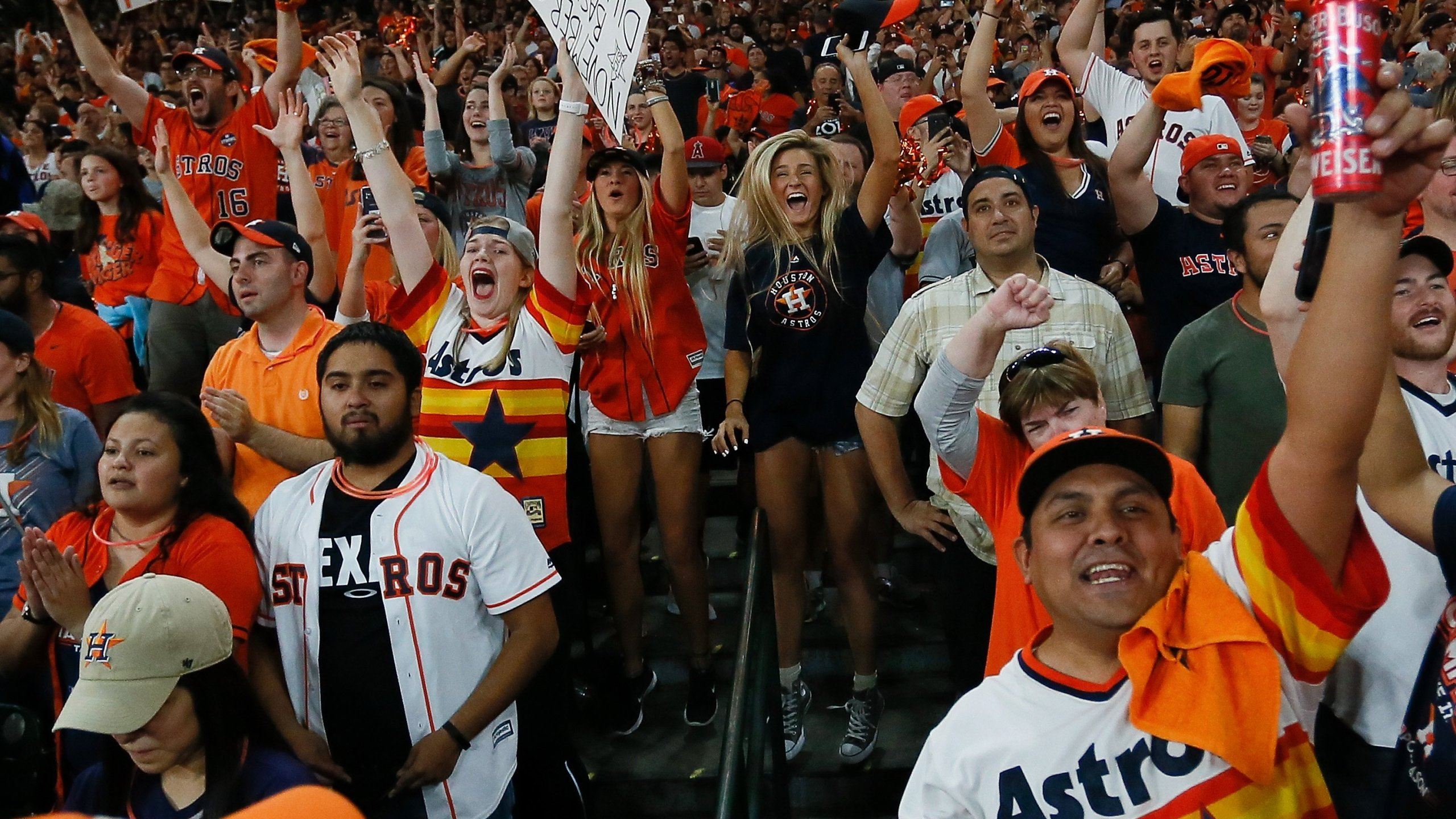 Houston fans celebrate after the Houston Astros defeated the Los Angeles Dodgers in Game 7 of the World Series during a Houston Astros World Series watch party at Minute Maid Park on Nov. 1, 2017, in Houston. (Credit: Bob Levey/Getty Images)