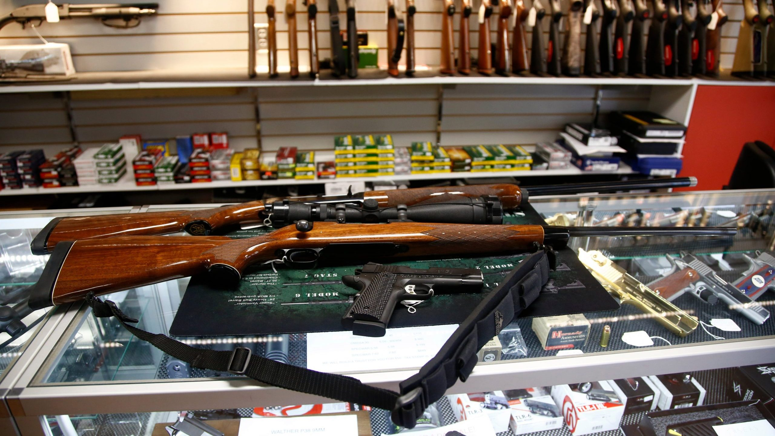 A Remington 700 hunting rifle, a Remington 1100 shotgun and a Remington R1 Enhanced model 1911 pistol are seen for sale at Atlantic Outdoors gun shop on March 26, 2018, in Stokesdale, North Carolina. (Credit: Brian Blanco/Getty Images)