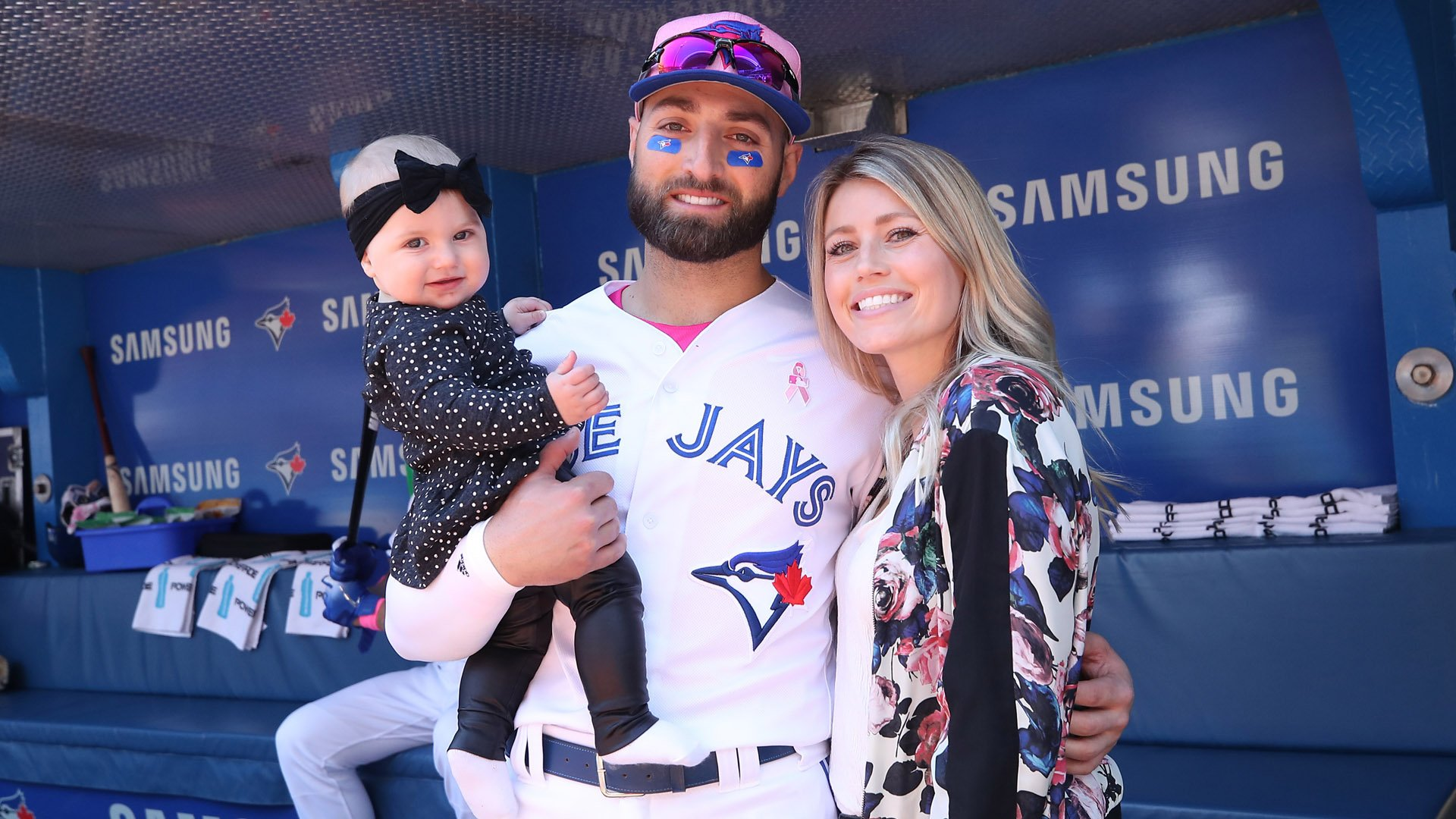 Kevin Pillar, formerly #11 of the Toronto Blue Jays, poses with his wife and baby on Mother's Day before the start of MLB game action against the Boston Red Sox at Rogers Centre on May 13, 2018, in Toronto, Canada. (Credit: Tom Szczerbowski/Getty Images)