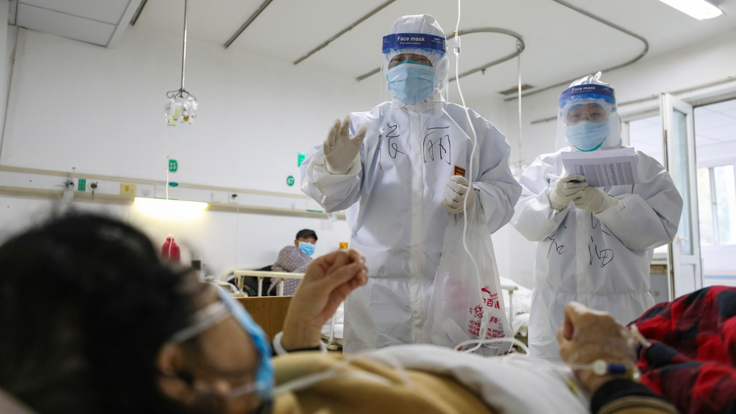 Medical personnel check the conditions of patients in Jinyintan Hospital in Wuhan, China on Feb. 13, 2020. (Credit: Barcroft Media via Getty Images)