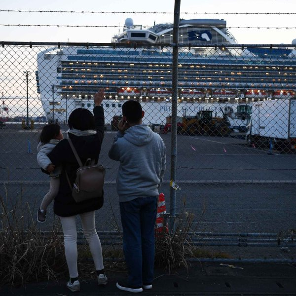 Relatives of passengers wave at the Diamond Princess cruise ship, with around 3,600 people quarantined onboard due to fears of coronavirus, as the ship departs from Daikoku Pier Cruise Terminal in Yokohama on Feb. 11, 2020. (Credit: Charly Triballeau/AFP via Getty Images)