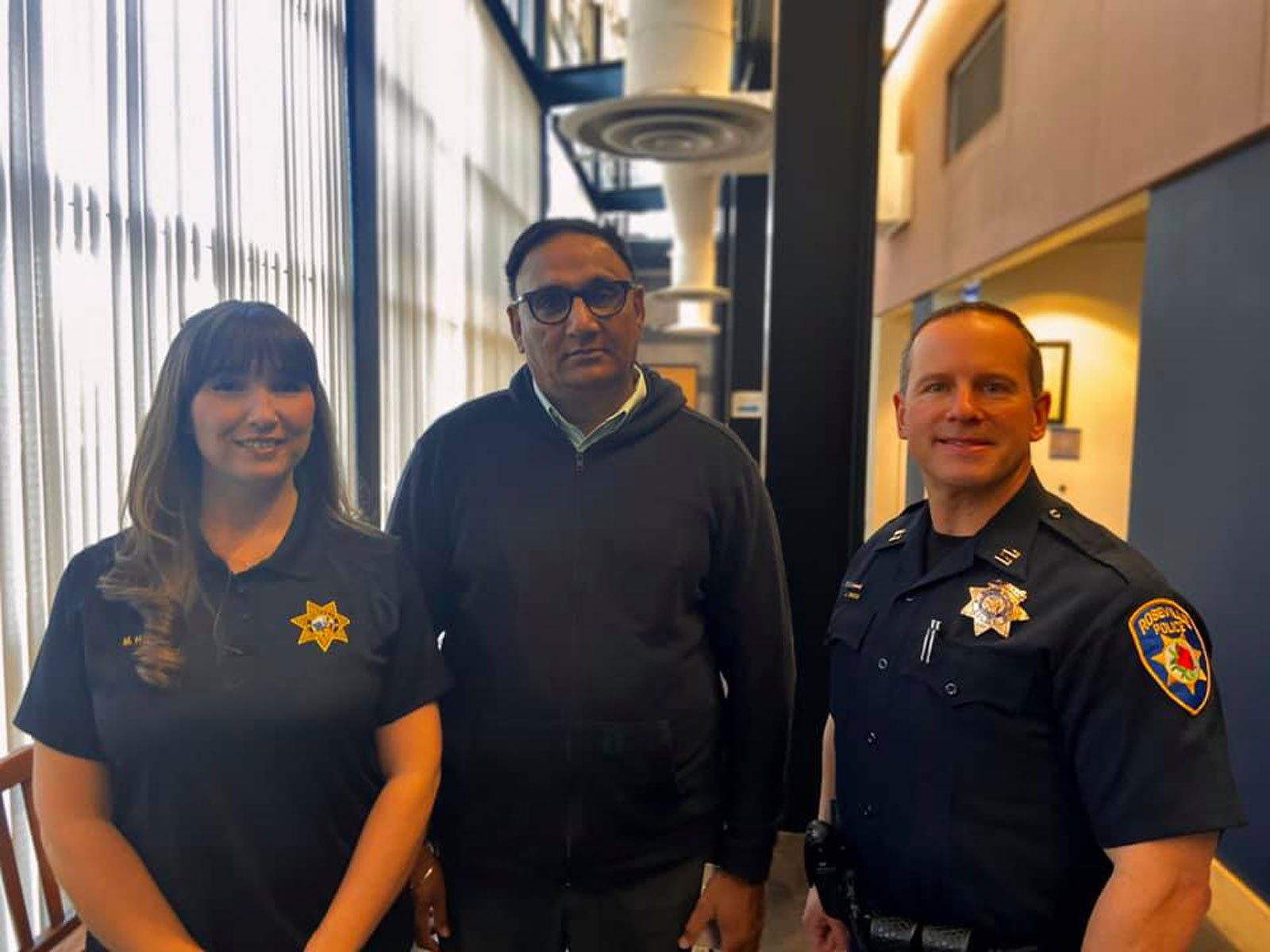 Rajbir Singh stands with Roseville Police records clerk Megan Harrigan and police Capt. Josh Simon in this undated photo. (Credit: Roseville Police Department via CNN)
