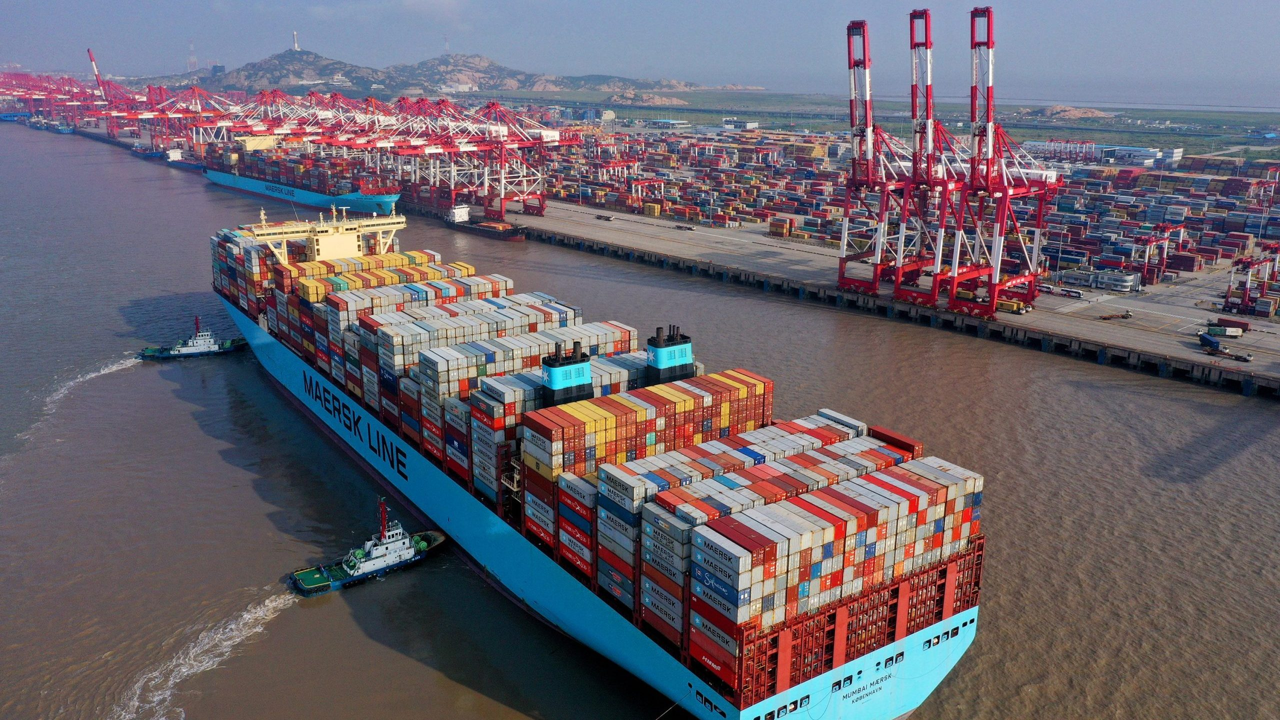 Tugboats guide a container ship at the Yangshan Deepwater Port on Oct. 4, 2019 in Shanghai, China. (Credit: Ji Haixin/VCG via Getty Images)