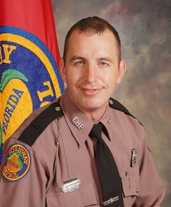 Trooper Joseph Bullock is seen in a photo released by the Florida Highway Patrol.