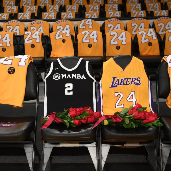 The Los Angeles Lakers honor Kobe Bryant and daughter Gigi by covering the courtside seats they occupied at Staples Center with flowers and their jerseys on Jan. 31, 2020. (Credit: Harry How / Getty Images)