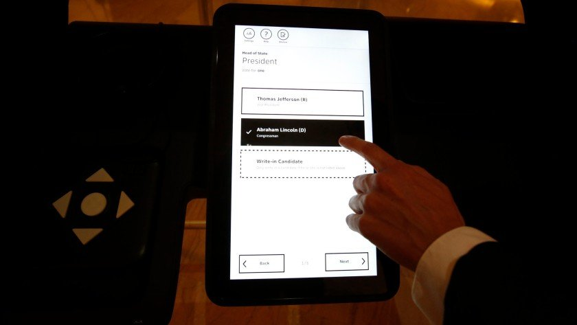 A 2020 image shows how Los Angeles County's new voting machines require voters to use a touch-screen to make choices that are then printed on a paper ballot. (Credit: Barbara Davidson / Los Angeles Times)