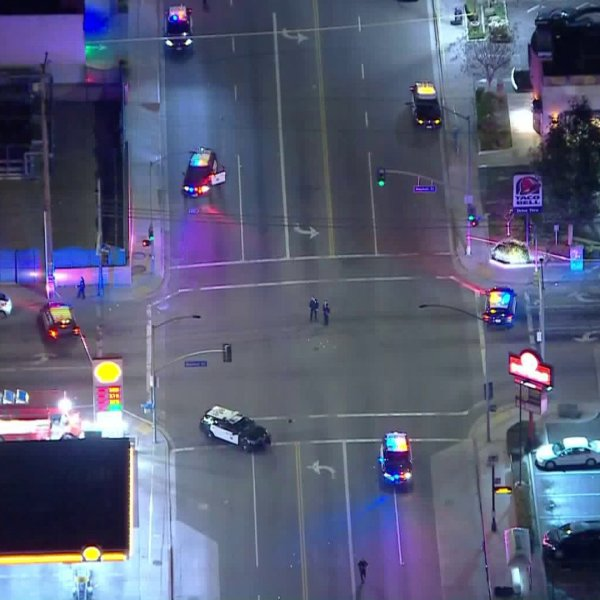 Police shut down the intersection of Atlantic Avenue and Market Street in Long Beach after a shooting on Feb. 20, 2020. (Credit: KTLA)