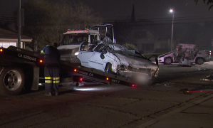 Crews tow away two vehicles that were involved in a deadly crash near Ramona Avenue and Howard Street in Montclair on Feb. 8, 2020. (Credit: KTLA)
