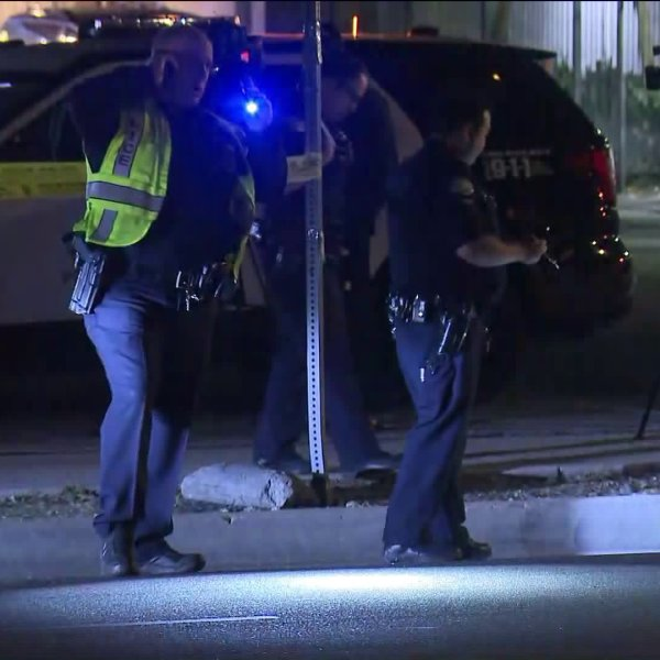 Police investigate the scene of a deadly hit-and-run in Pacoima on Feb. 6, 2020. (Credit: KTLA)