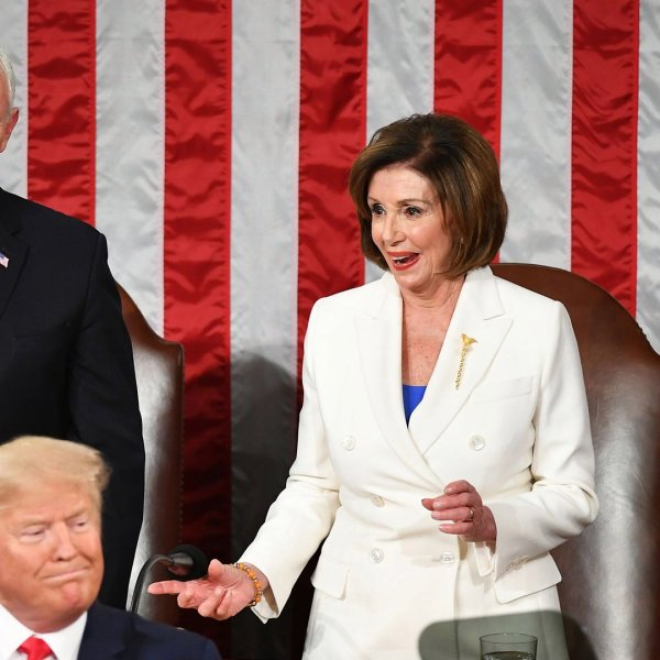 U.S. Vice President Mike Pence watches as House Speaker Nancy Pelosi, D-CA, reacts after reaching out to shake hands with U.S. President Donald Trump as he arrives to deliver the State of the Union address in the House chamber of the U.S. Capitol in Washington, D.C. on Feb. 4, 2020. (Credit: MANDEL NGAN/AFP via Getty Images)