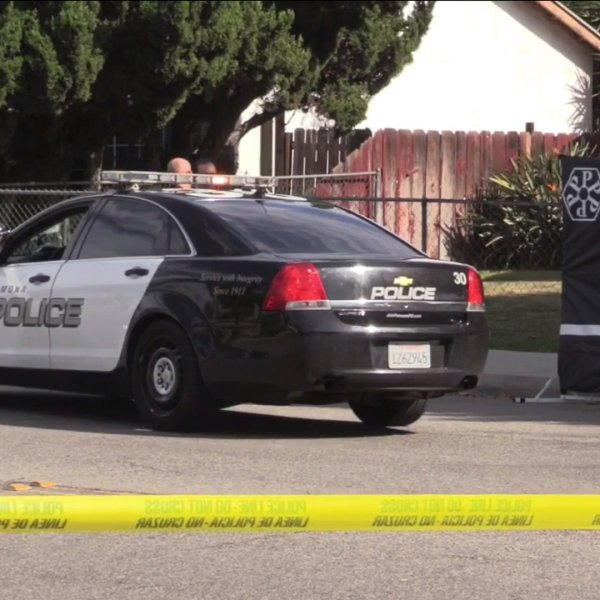Police investigate a fatal shooting in Pomona on Feb. 3, 2020. (Credit: OC Hawk)