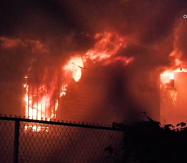 Flames tear through a home in Pomona on Feb. 5, 2020. (Credit: OnScene.TV)