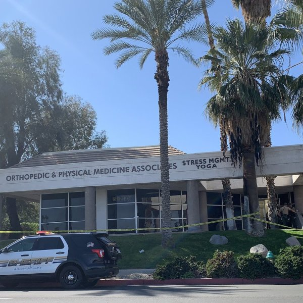 Deputies respond to the scene where two men were found dead in a Rancho Mirage medical office on Feb. 14, 2020, in a photo provided by the Riverside County Sheriff's Department.