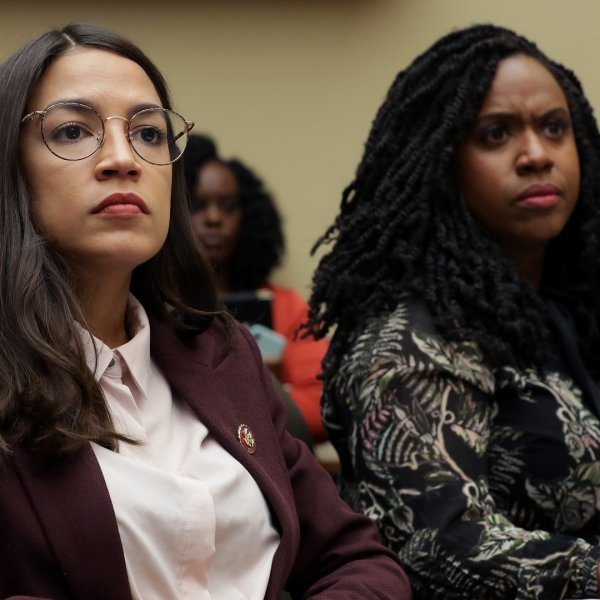 Reps. Alexandria Ocasio-Cortez (left) and Ayanna Pressley attend a Capitol Hill hearing on drug pricing on July 26, 2019. (Credit: Chip Somodevilla / Getty Images)
