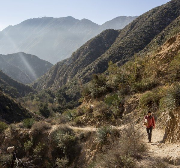 Bryan Matsumoto, program organizer for Nature For All, hikes the Trail Canyon Falls trail in the western San Gabriel Mountains in this undated photo. (Credit: Gabriella Angotti-Jones / Los Angeles Times)