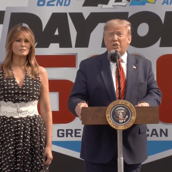 Donald Trump, standing beside Melania Trump, addresses the crowd at Daytona 500 in Florida on Feb. 16, 2020. (Credit: CNN)
