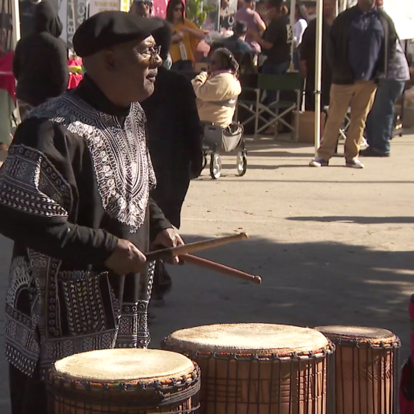 A man plays the drums during a Black History Month celebration in Leimert Park on Feb. 16, 2020.