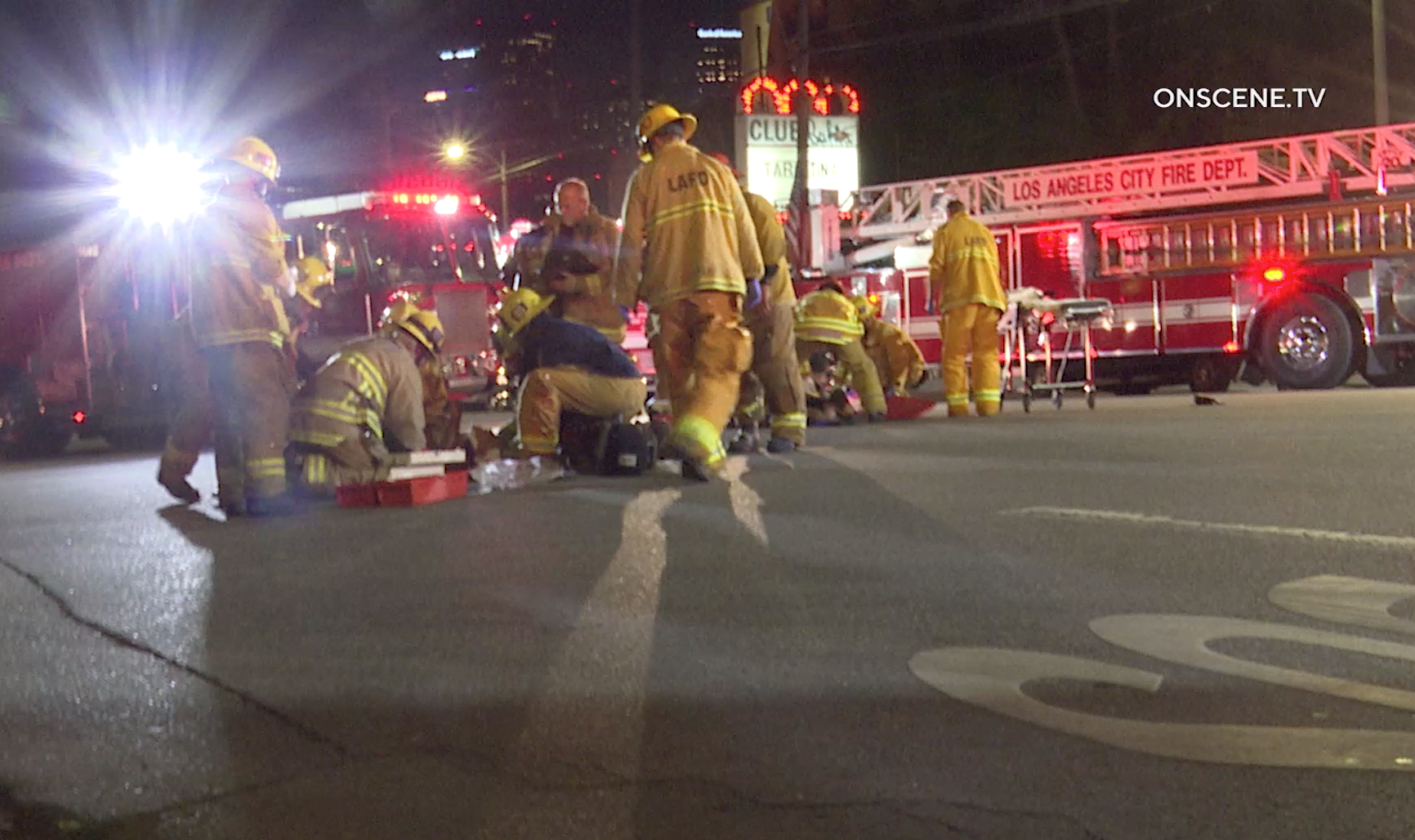 Los Angeles Fire Department crews attend to a couple injured in a hit-and-run crash on Sunset Boulevard in Echo Park on Feb. 24, 2020. (Credit: ONSCENE.TV)