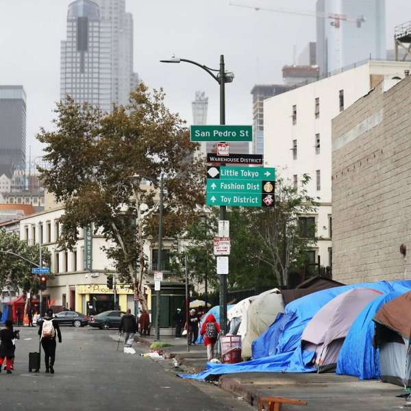 People walk in Los Angeles' Skid Row on Sept. 28, 2019. (Credit: Mario Tama / Getty Images)