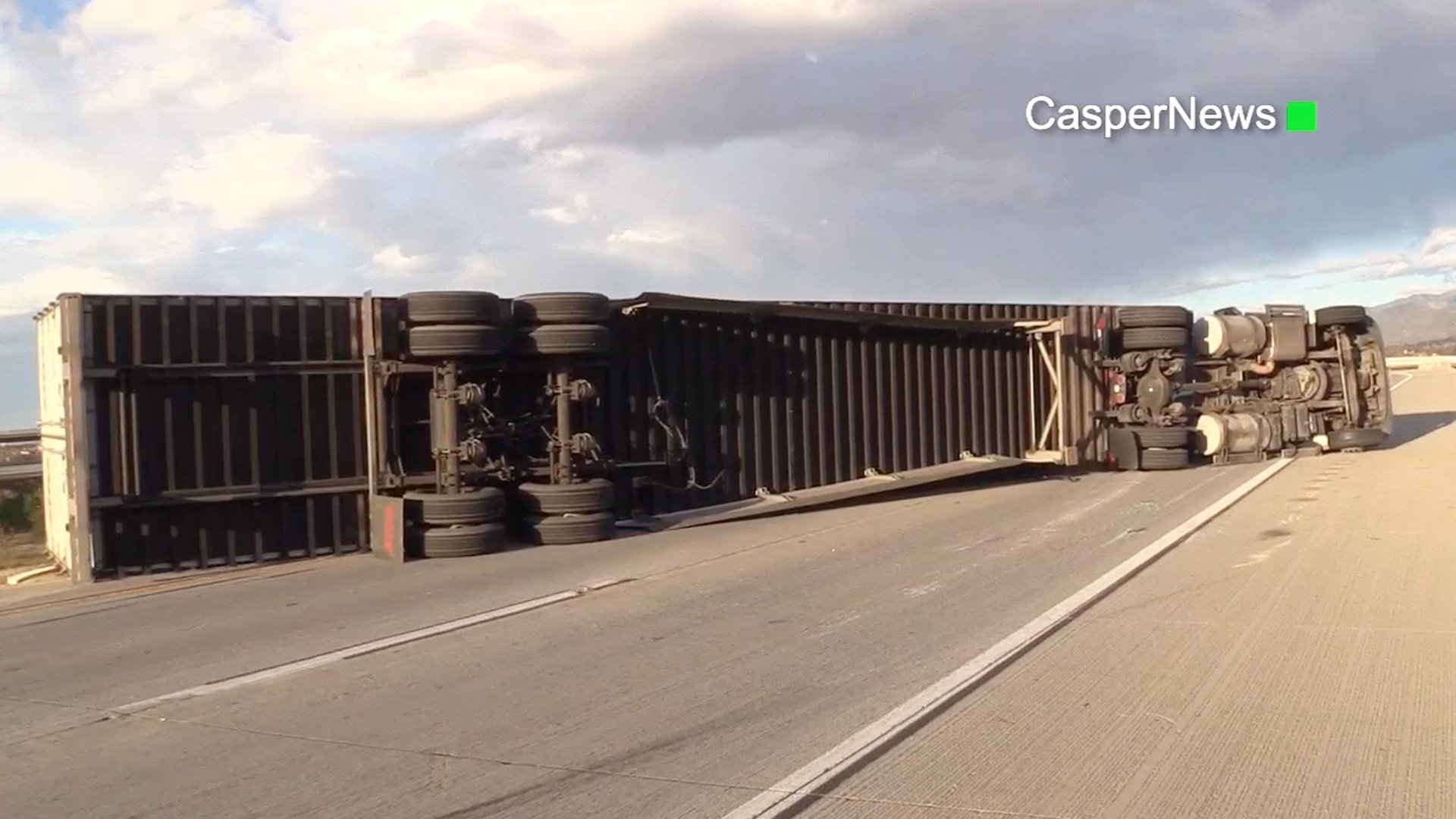 Powerful winds blew over a big rig hauling more than two tons of furniture in the Fontana area on Feb. 10, 2020. (Credit: CasperNews)