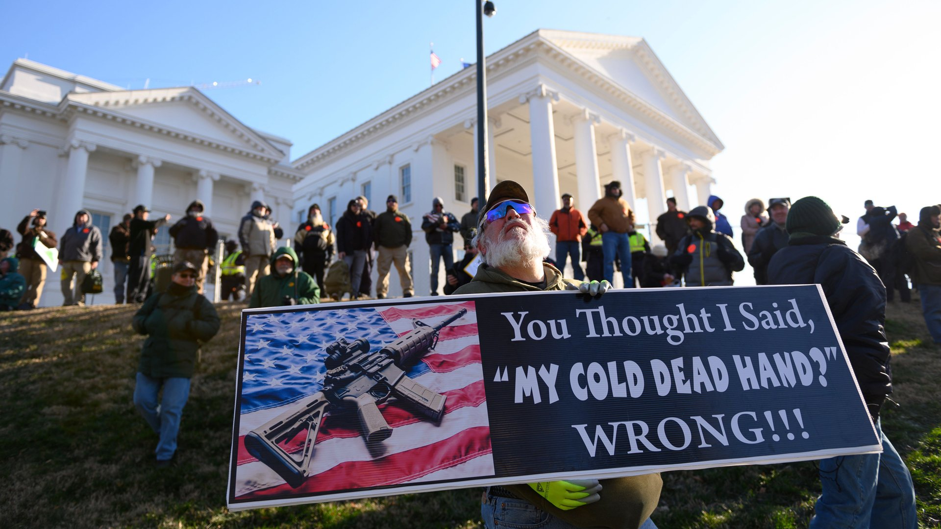 A pro-gun demonstrator holds a sign outside the Virginia State Capitol in Richmond on Jan. 20, 2020. (Credit: Roberto Schmidt / AFP/ Getty Images)