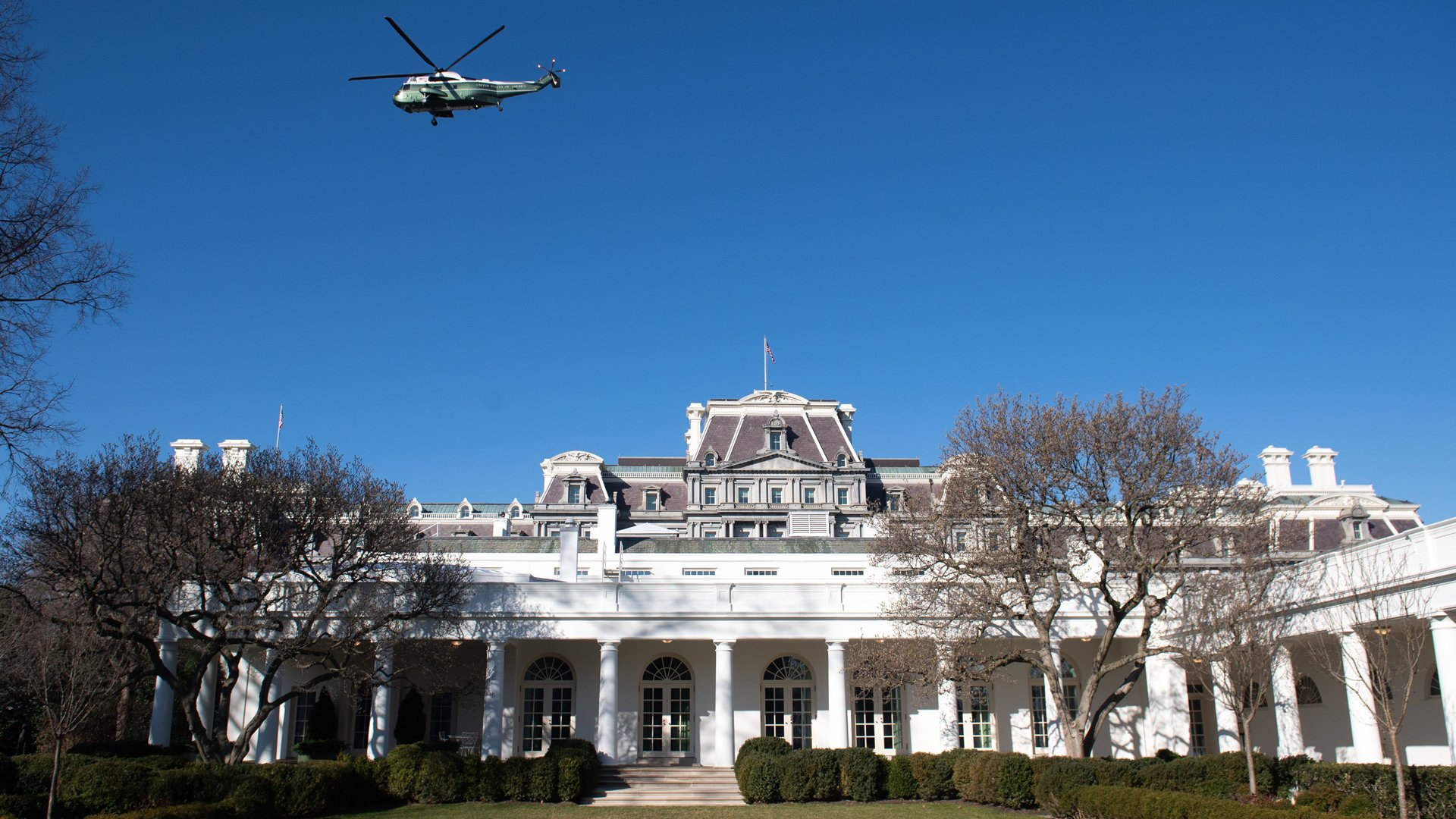 A backup helicopter to Marine One flies over the West Wing and Rose Garden of the White House as US President Donald Trump and First Lady Melania Trump depart the South Lawn in Washington, DC, February 23, 2020, as they leave on a 2-day trip to India. (Credit: Saul Loeb/AFP/Getty Images)