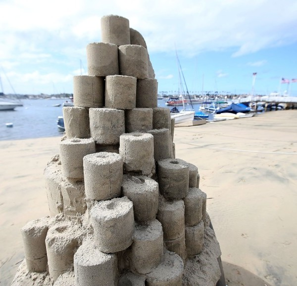 "A toilet paper tower titled ""Roll With It"" by sandcastle artist Chris Crosson rises on Balboa Island in Newport Beach.(Don Leach / Times Community News)"