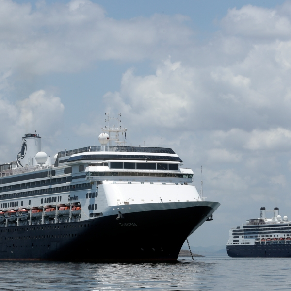 The Zaandam cruise ship, left, carrying guests with flu-like symptoms, is anchored shortly after it arrived in the bay of Panama City on Friday. (AP Photo/Arnulfo Franco)