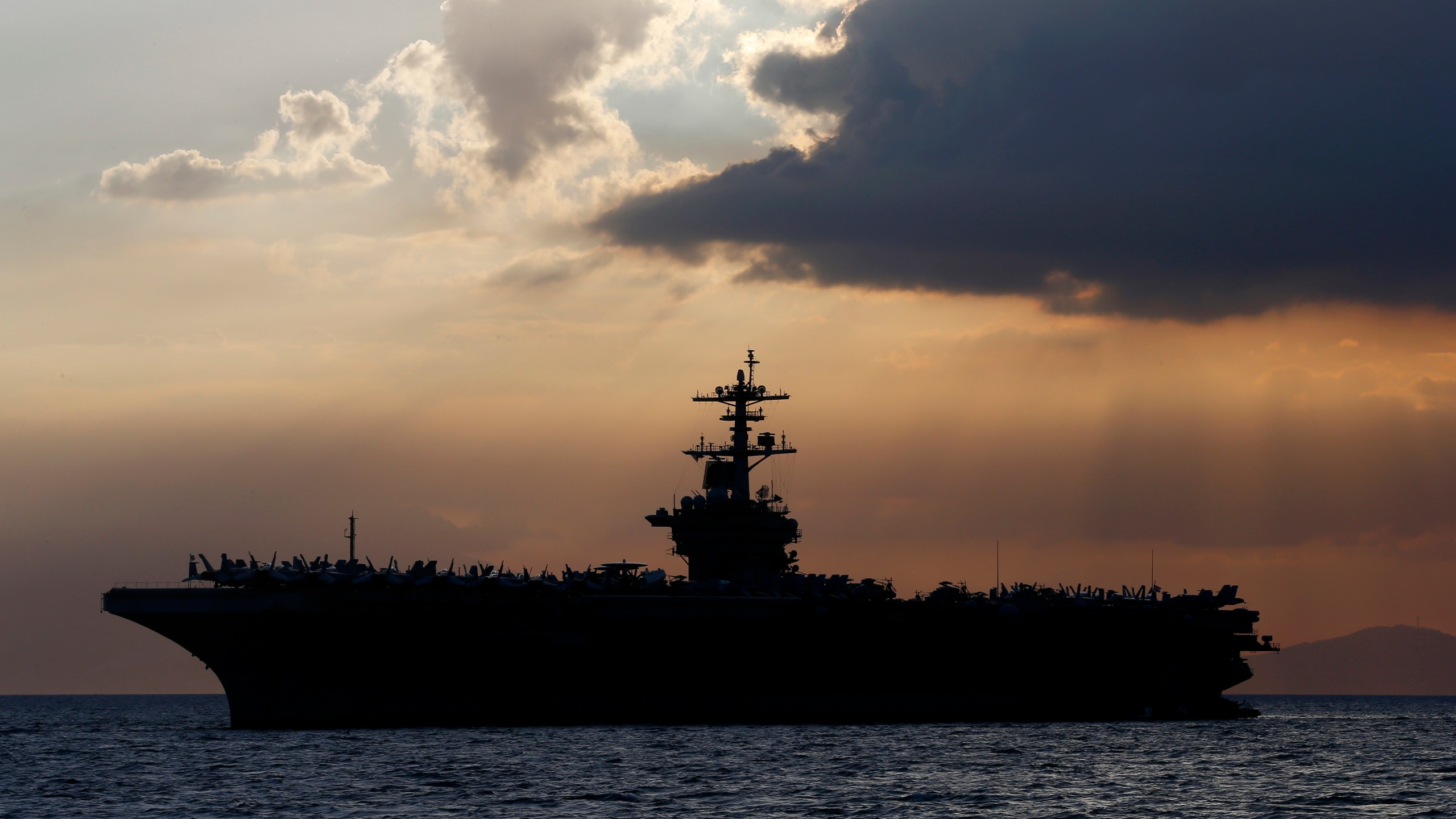 The USS Theodore Roosevelt aircraft carrier anchored off Manila Bay west of Manila, Philippines in 2018. (AP Photo/Bullit Marquez, File)