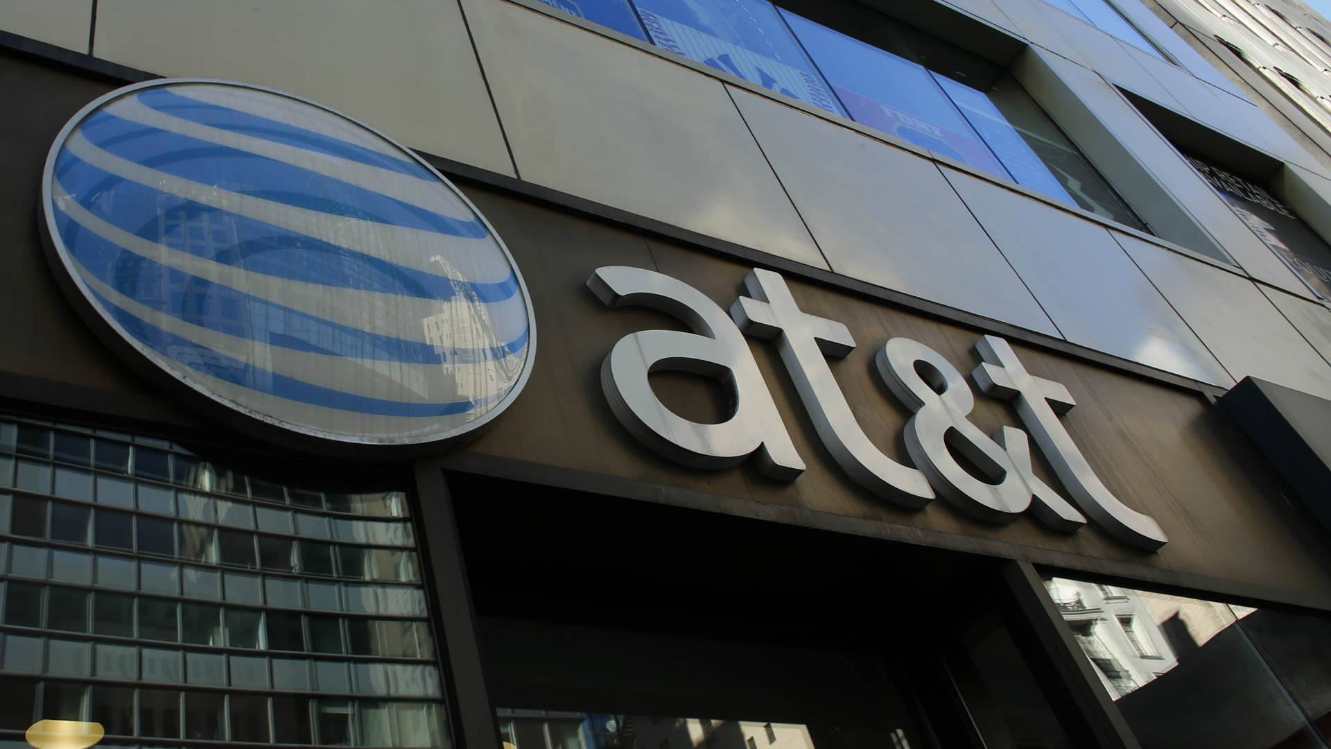 An AT&T sign at a store in New York City is seen in this file photo from Oct. 23, 2016. (KENA BETANCUR/AFP via Getty Images)