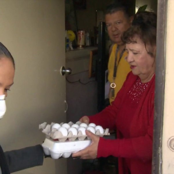 Volunteers in Boyle Heights deliver food and supplies to seniors on March 25, 2020. (KTLA)