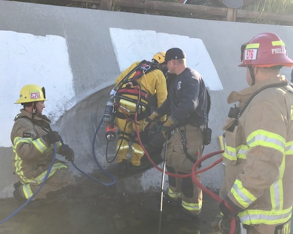 Firefighters work to rescue a man who was stuck in a storm drainage pipe in Temecula on March 4, 2020. (Cal Fire Riverside/Twitter)