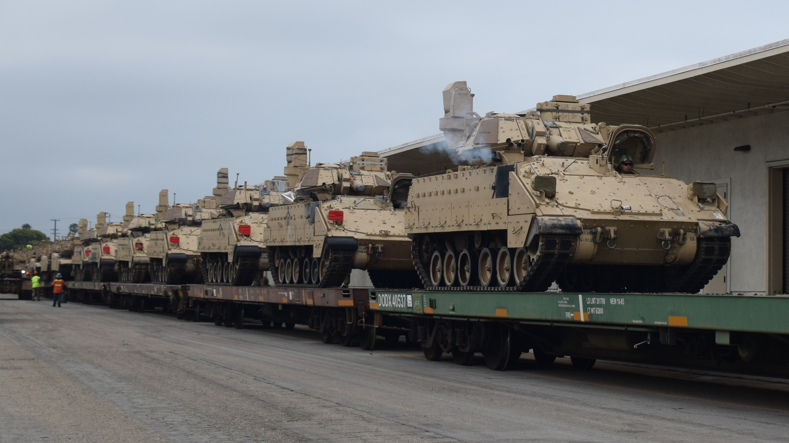 A photo shared by Naval Base Ventura County shows tanks being hauled on a train on March 24, 2020.