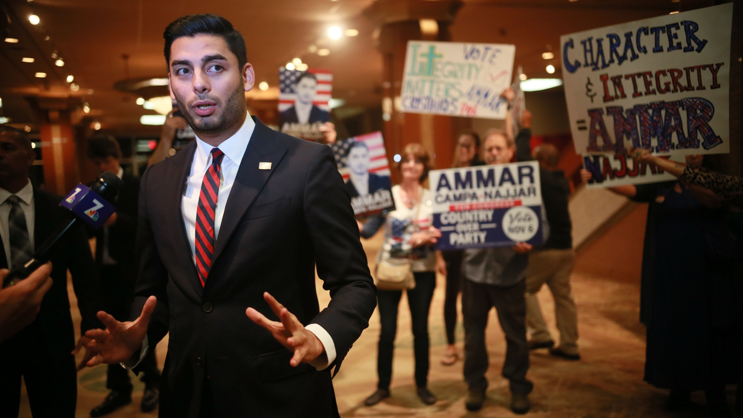 Ammar Campa-Najjar is seen with supporters in San Diego on Nov. 6, 2018. (Credit: Sandy Huffaker / Getty Images)