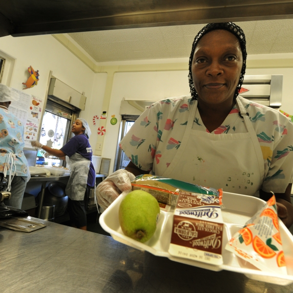 Cafeteria workers prepare lunches for school children at the Normandie Avenue Elementary School in South Central Los Angeles on Dec. 2, 2010. (MARK RALSTON/AFP via Getty Images)
