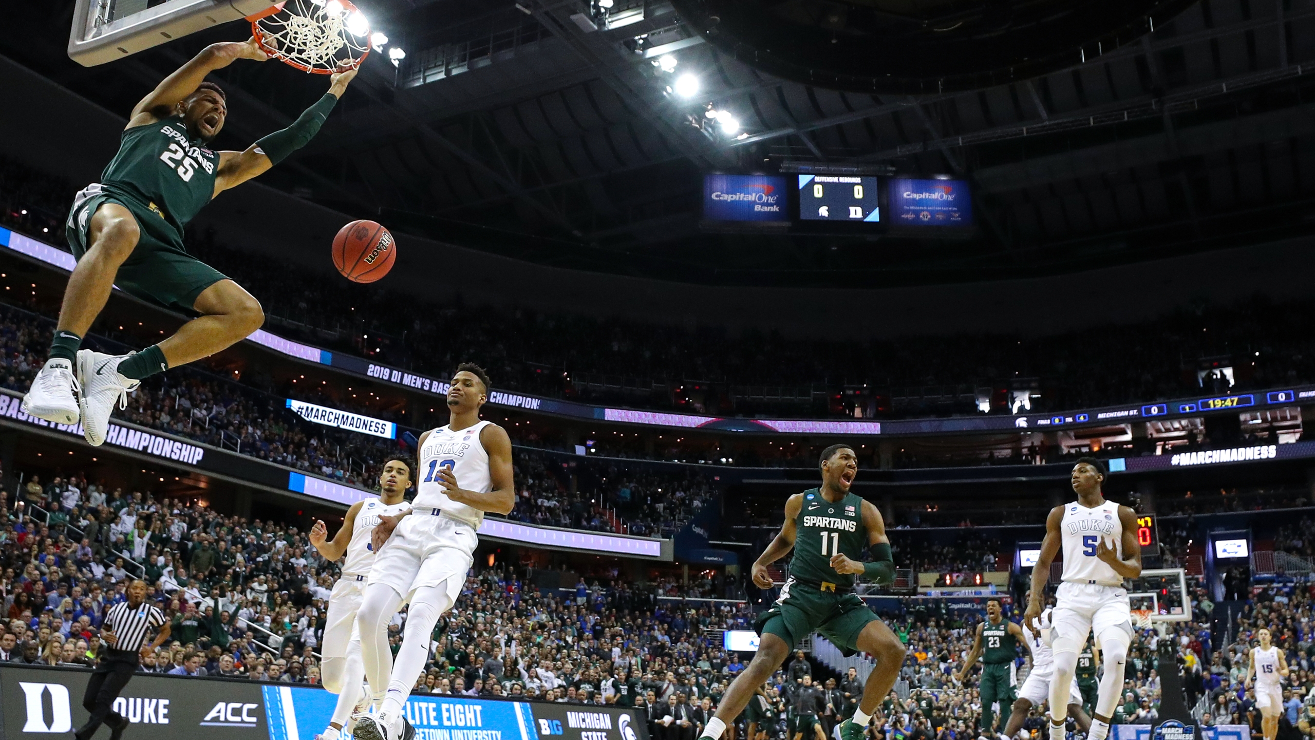 Kenny Goins #25 of the Michigan State Spartans dunks the ball against the Duke Blue Devils during the first half in the East Regional game of the 2019 NCAA Men's Basketball Tournament at Capital One Arena on March 31, 2019 in Washington, D.C. (Patrick Smith/Getty Images)