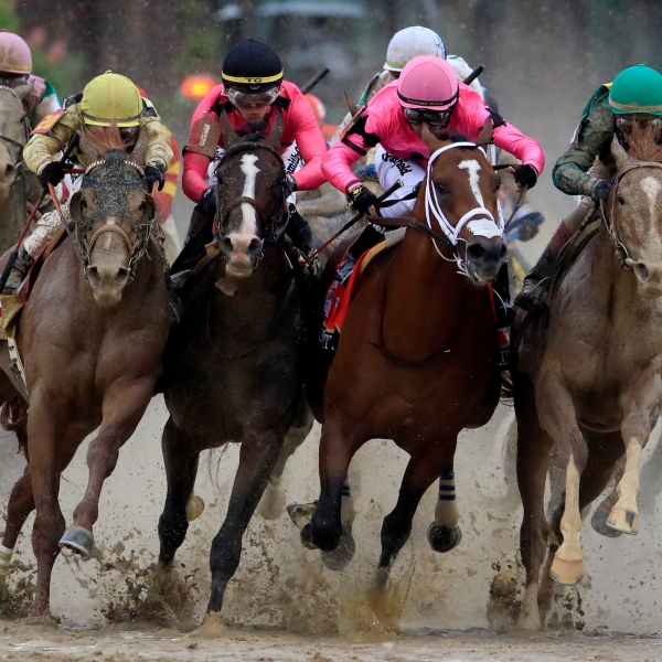 Country House, War of Will, Maximum Security and Code of Honor fight for position in the final turn during the 145th running of the Kentucky Derby in Louisville on May 4, 2019. (Credit: Andy Lyons / Getty Images)
