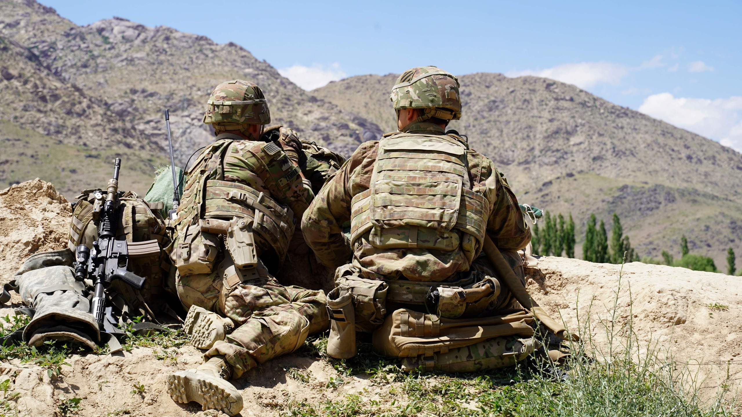 In this photo taken on June 6, 2019, US soldiers look out over hillsides during a visit of the commander of US and NATO forces in Afghanistan General Scott Miller at the Afghan National Army (ANA) checkpoint in Nerkh district of Wardak province. (THOMAS WATKINS/AFP via Getty Images)