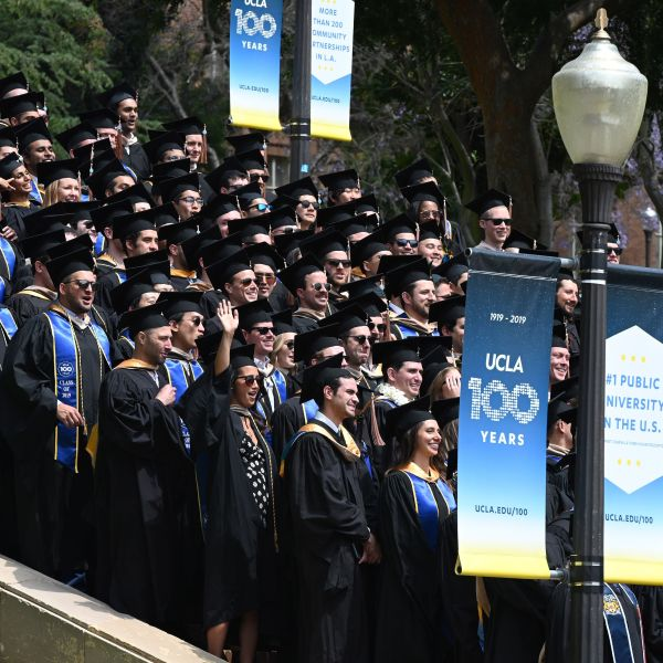 Graduating students pose for a class picture at UCLA on June 14, 2019. (ROBYN BECK/AFP via Getty Images)