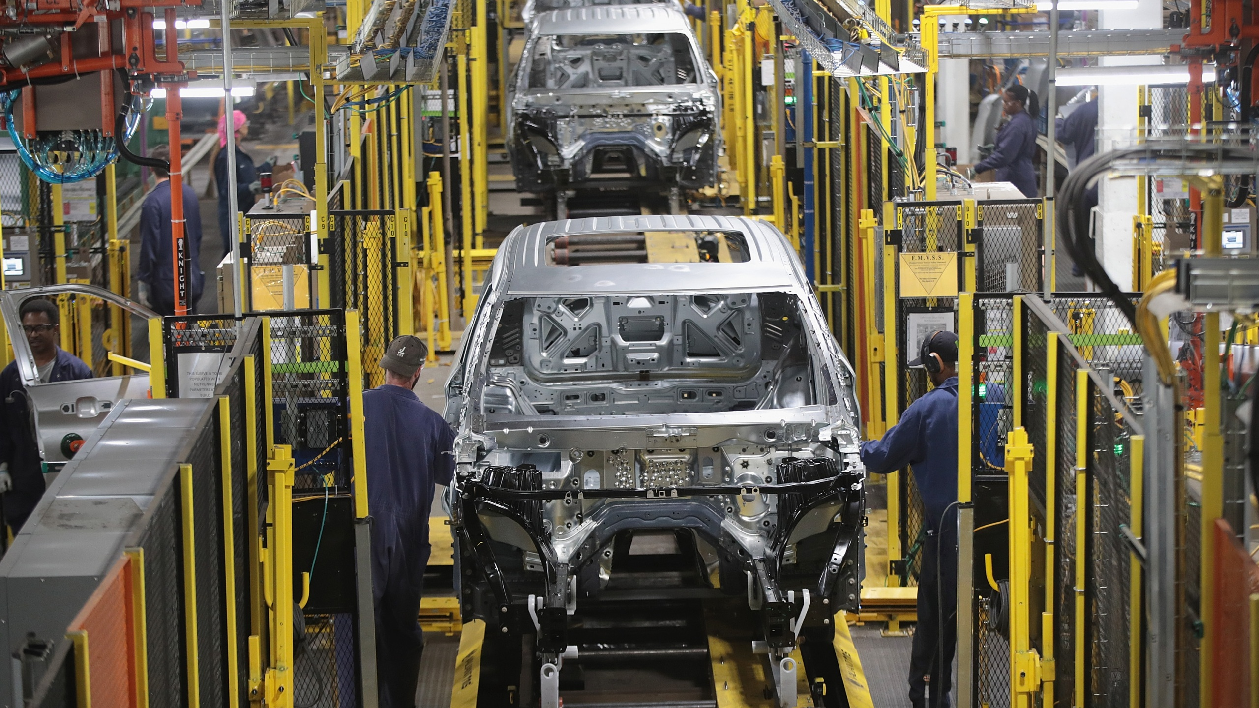 Workers assemble Ford vehicles at the Chicago Assembly Plant on June 24, 2019 in Chicago, Illinois. (Scott Olson/Getty Images)