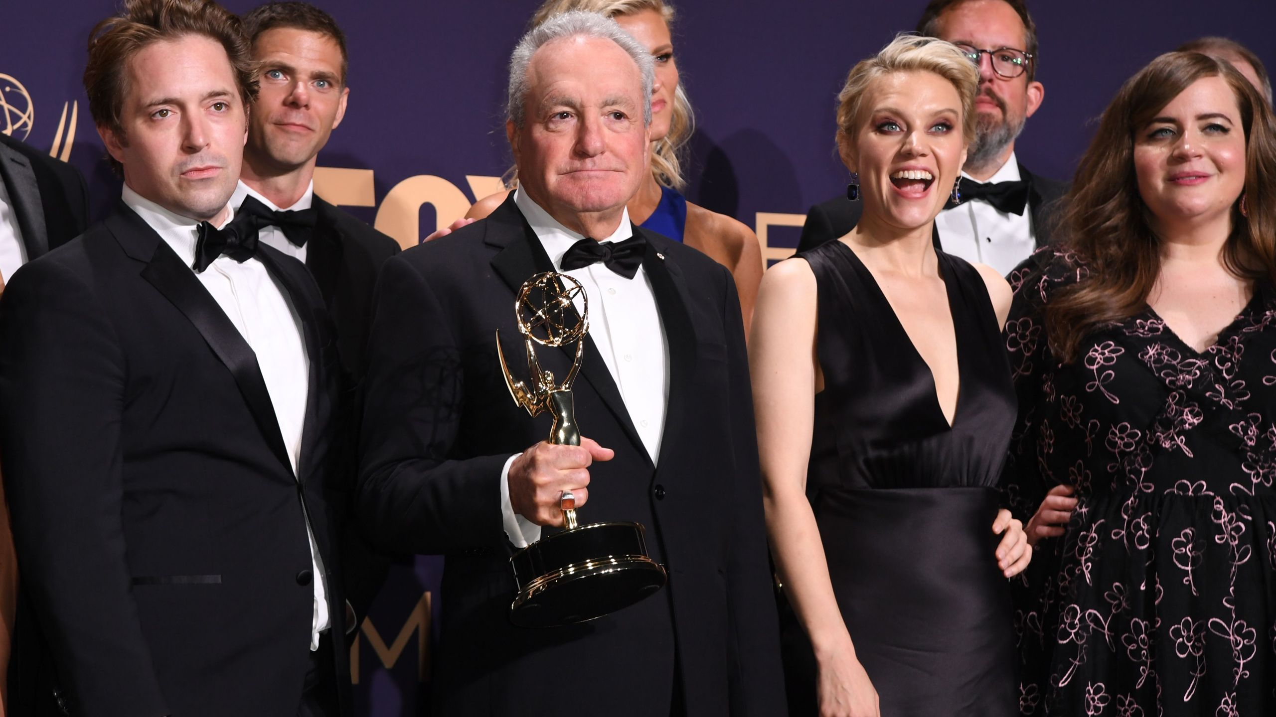 "Producer Lorne Michaels and cast members pose with the Outstanding Variety Sketch Series award for ""Saturday Night Live"" during the 71st Emmy Awards at the Microsoft Theatre in Los Angeles on Sept. 22, 2019. (ROBYN BECK/AFP via Getty Images)"
