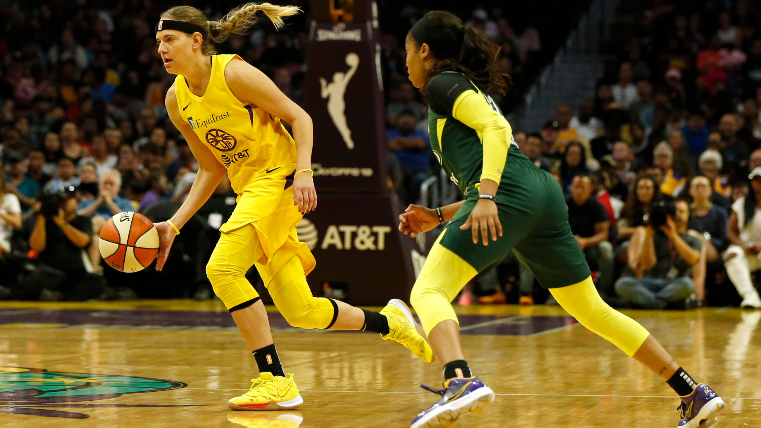 Guard Sydney Wiese #24 of the Los Angeles Sparks drives around guard Jordin Canada #21 of the Seattle Storm at Staples Center on Sept. 15, 2019. in Los Angeles. (Katharine Lotze/Getty Images)